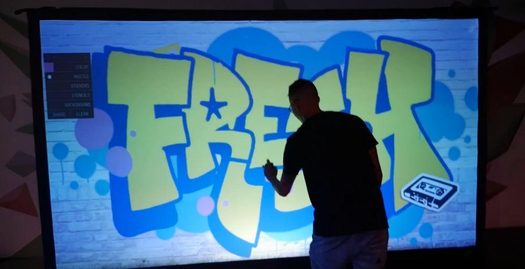 Artist doing digital graffiti wallvancouver mural festival