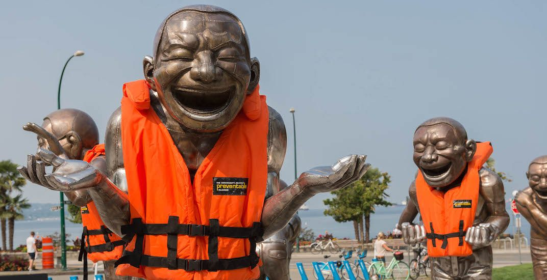 Famous laughing men statues at English Bay now wearing lifejackets