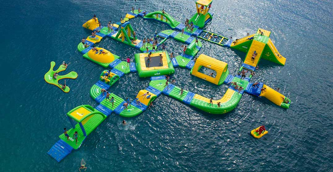 Relive your childhood on this epic floating water park this summer
