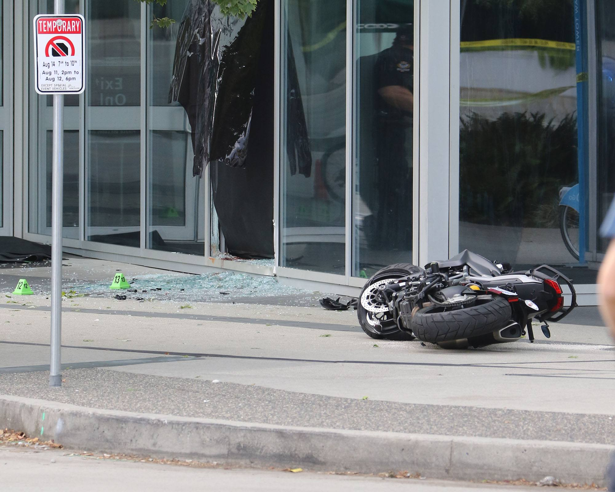 The motorcycle reportedly crashed through a window of the Shaw Tower near Jack Poole Plaza on Canada Place Way. (Daily Hive)
