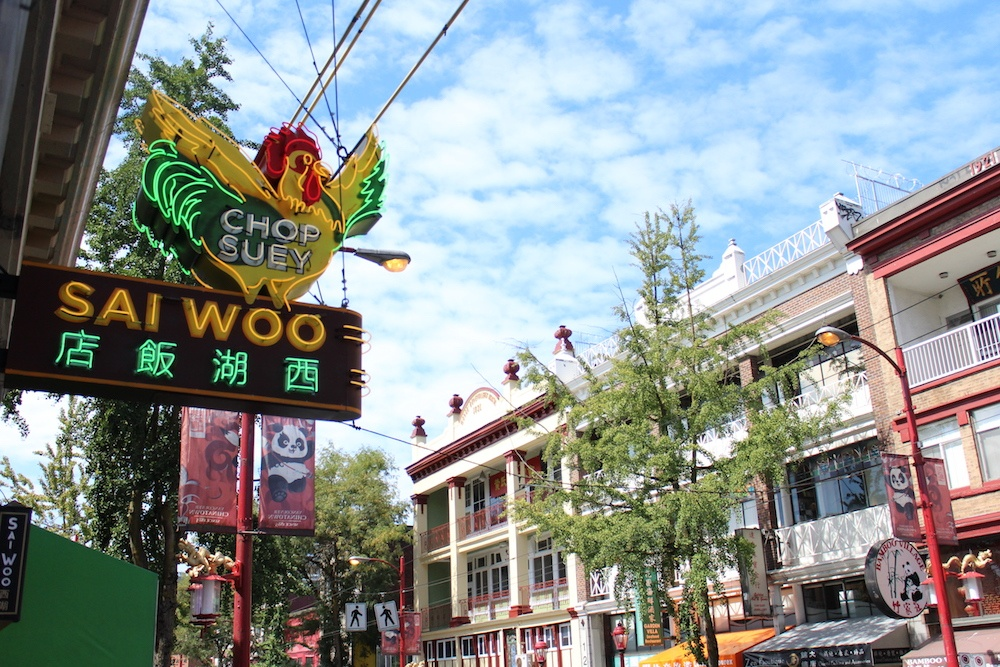 The neon rooster now sits outside the Sai Woo restaurant at 158 E Pender St, Vancouver (Chandler Walter/Daily Hive)