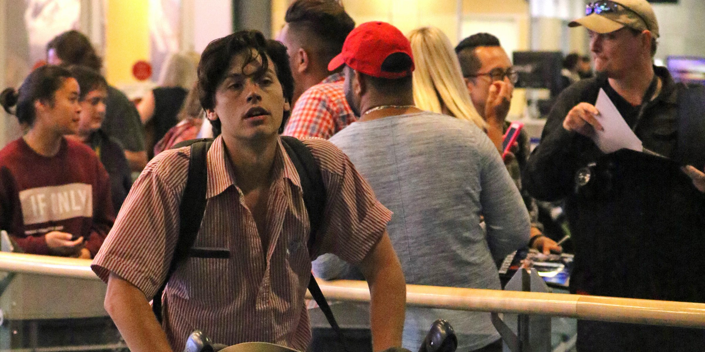 Cole Sprouse takes time for fans at Vancouver International Airport (PHOTOS)