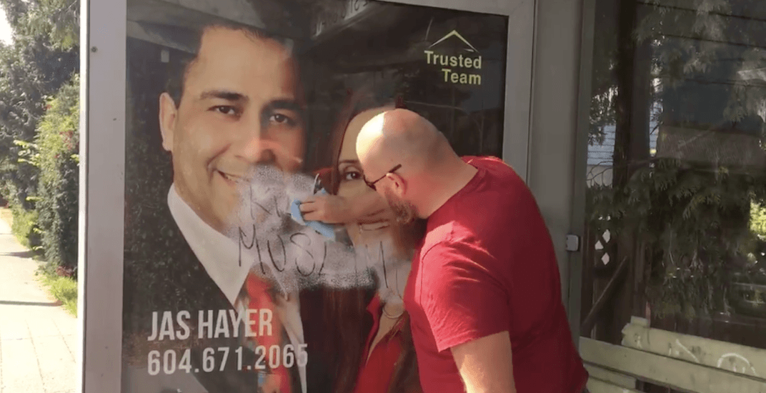 Vancouver man cleans racist graffiti off bus stop during his work day (VIDEO)
