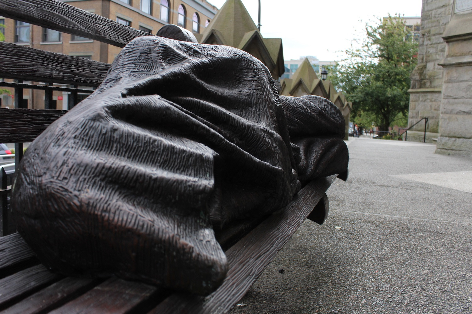 From the street the sculpture can be mistaken for a real person. (Chandler Walter/Daily Hive)