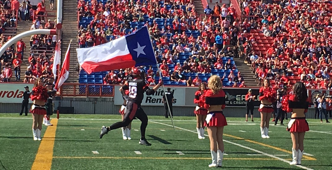 Bo Levi Mitchell carries Texas flag before Stampeders Labour Day Classic (VIDEO)