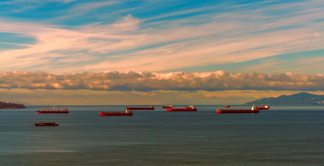 Cargo ships in english bay vancouver leonwangshutterstock