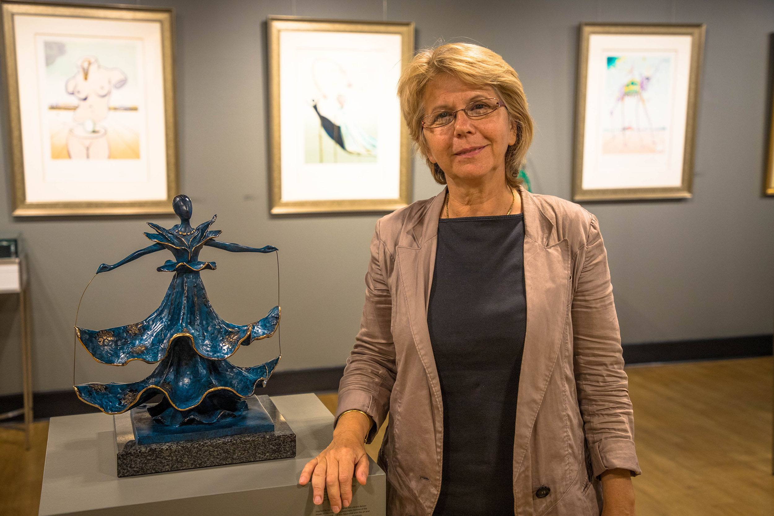 Susanna Strem, Chali-Rosso Gallery owner, with Salvador Dalí's Dalinian Dancer (Jenni Sheppard/Daily Hive)