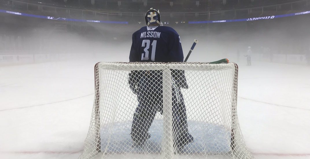 Canucks practice in the fog in China (PHOTOS)