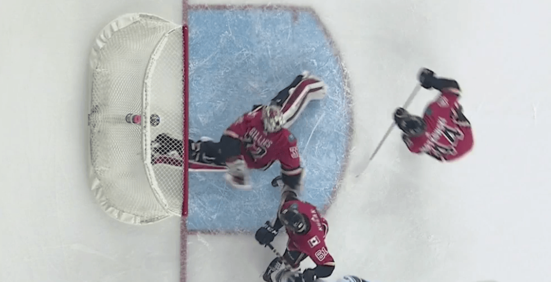 Flames goalie Jon Gillies makes amazing behind the back save (VIDEO)