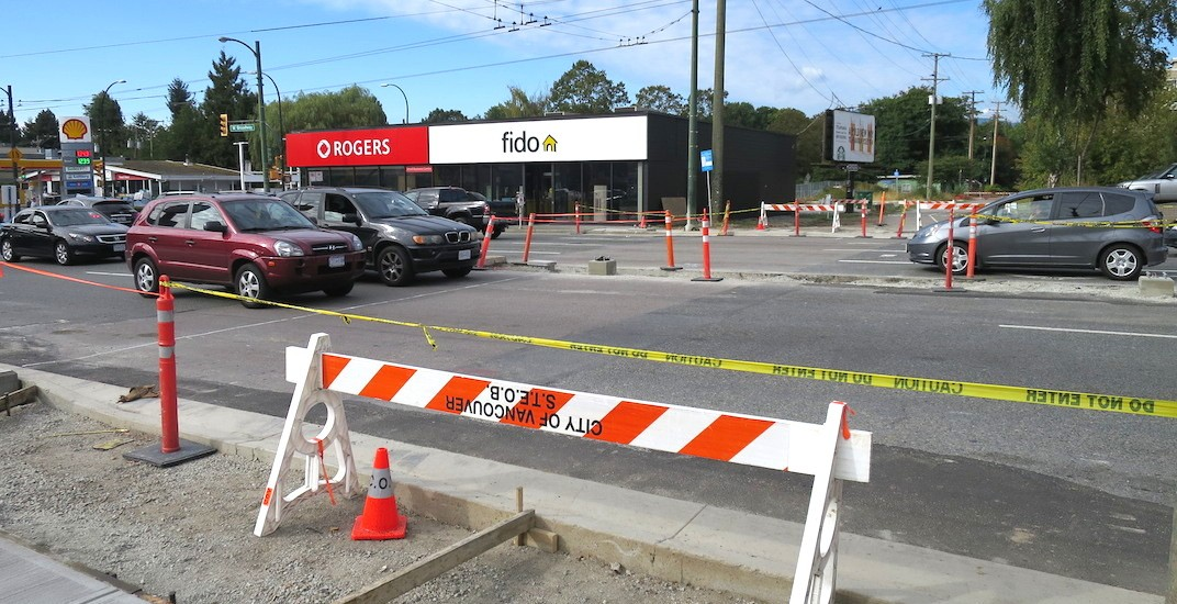 Traffic signal crosswalk being installed on Broadway at Arbutus Greenway