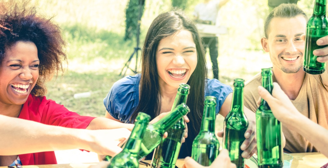 People drinkingbeer in the park shutterstock