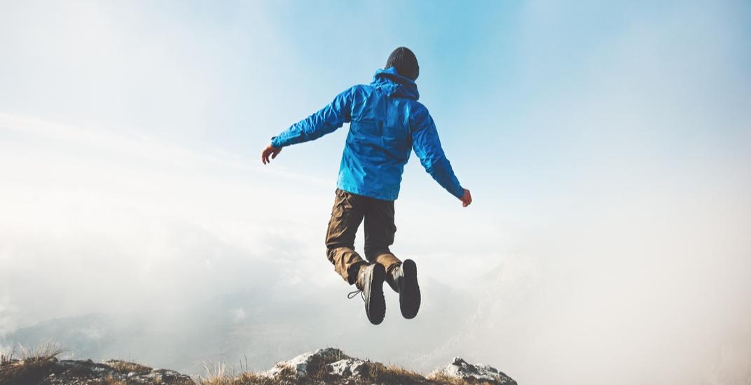 Hiker jumping shutterstock