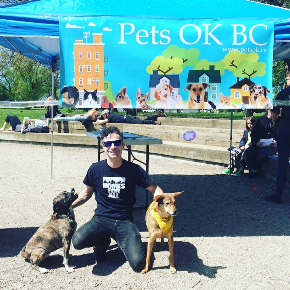 Pets OK BC co-organizer Eliot Galan (and dogs) ready to collect signatures for the petition (Pets OK BC/Facebook)