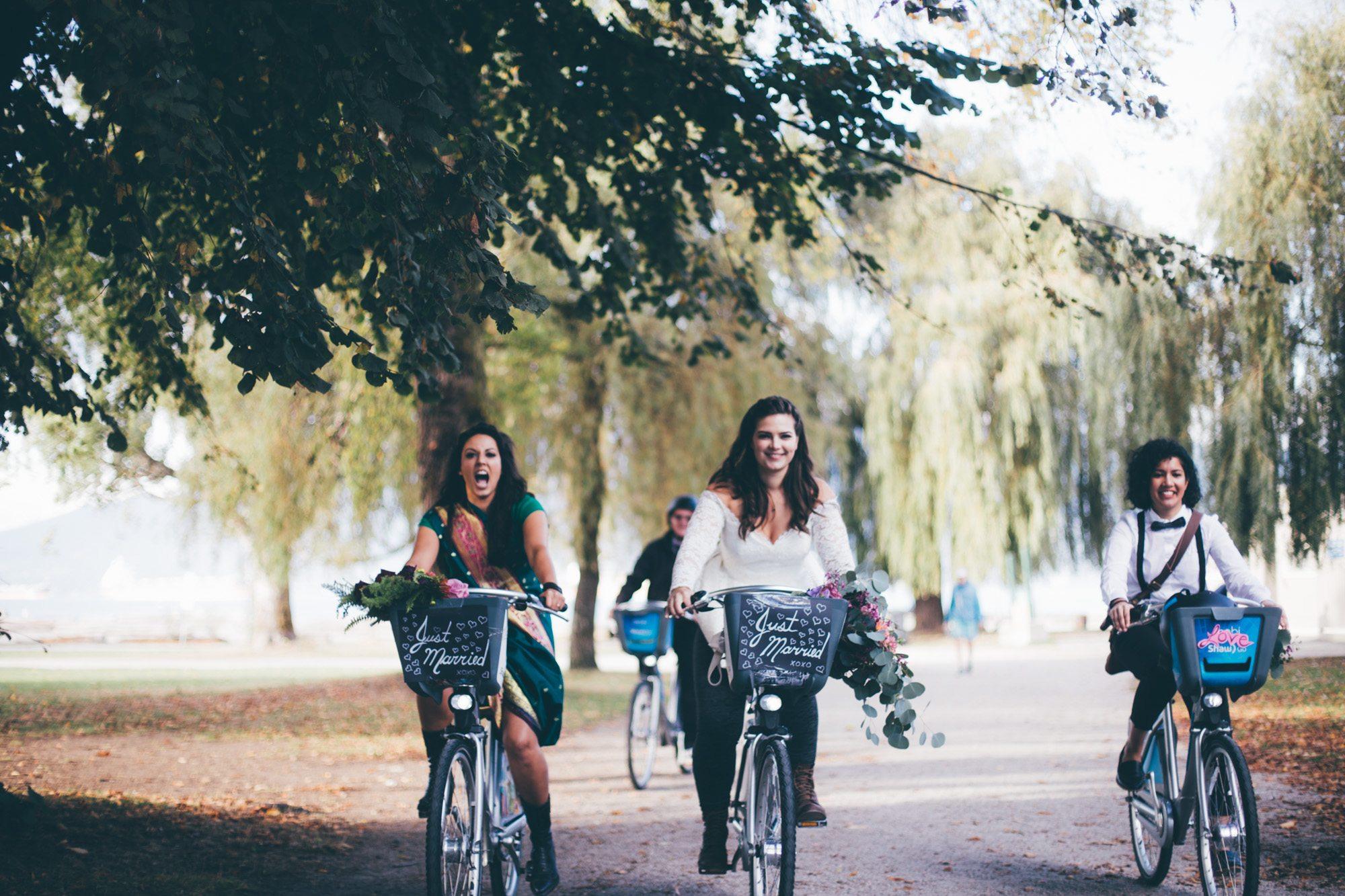 Newlyweds Leah Day and Kaitlin Straker on Mobi bikes (Kateland Abbigail Clarke)