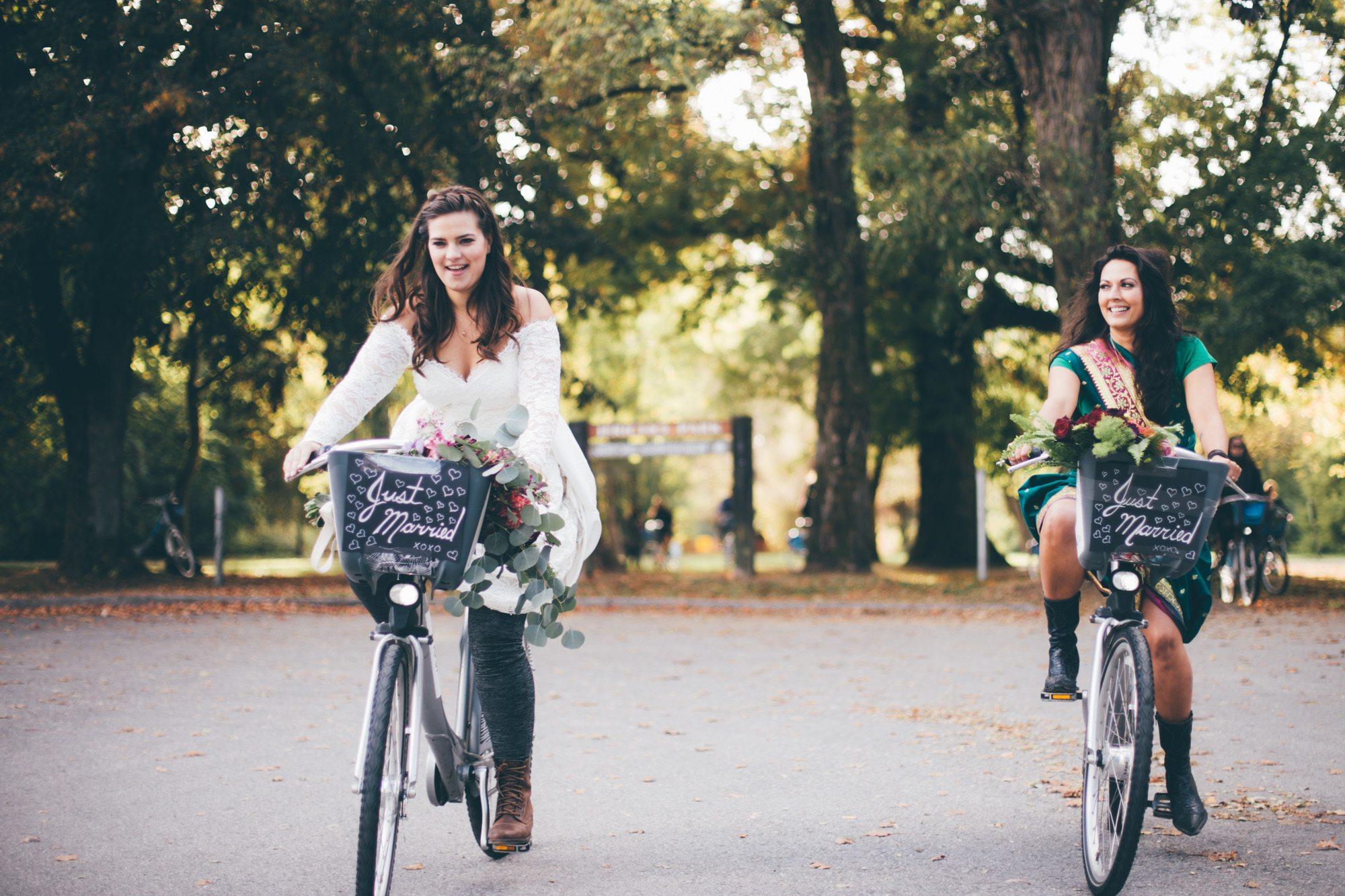 Newlyweds Kaitlin Straker and Leah Day on Mobi bikes (Kateland Abbigail Clarke)