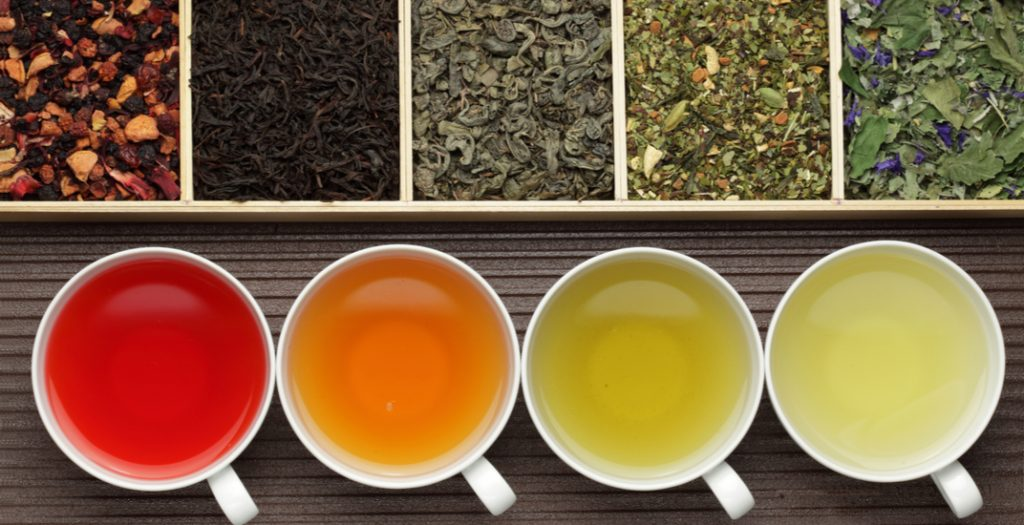 Tea assortment in boxes and cups