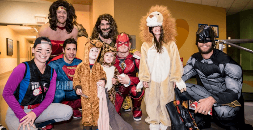 Flames players visit Children's Hospital dressed up as superheroes on Halloween (PHOTOS)