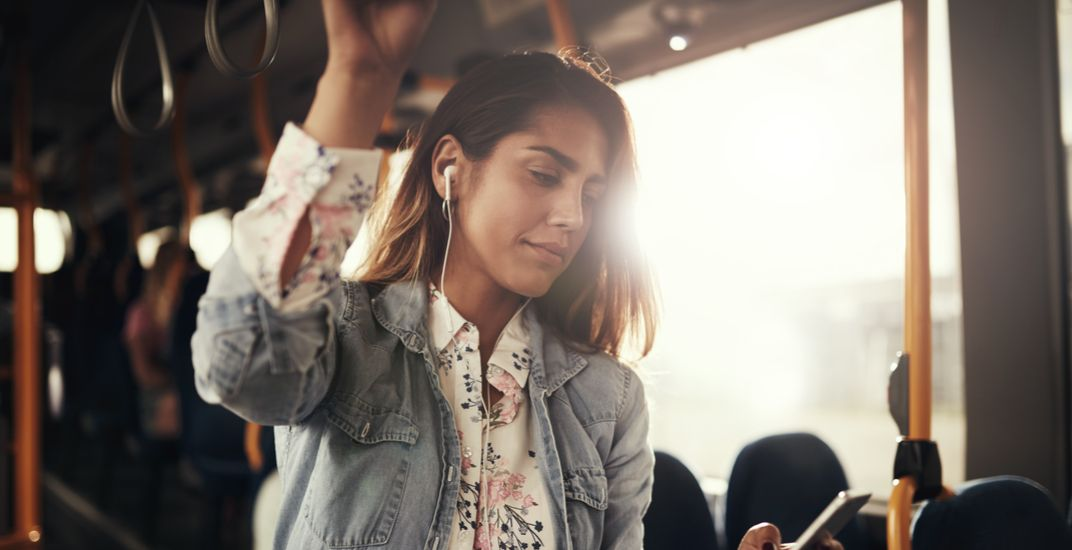 Listening to music on the bus