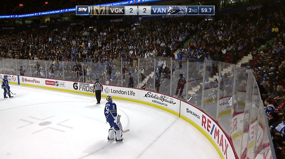 canucks-fan-hit-puck