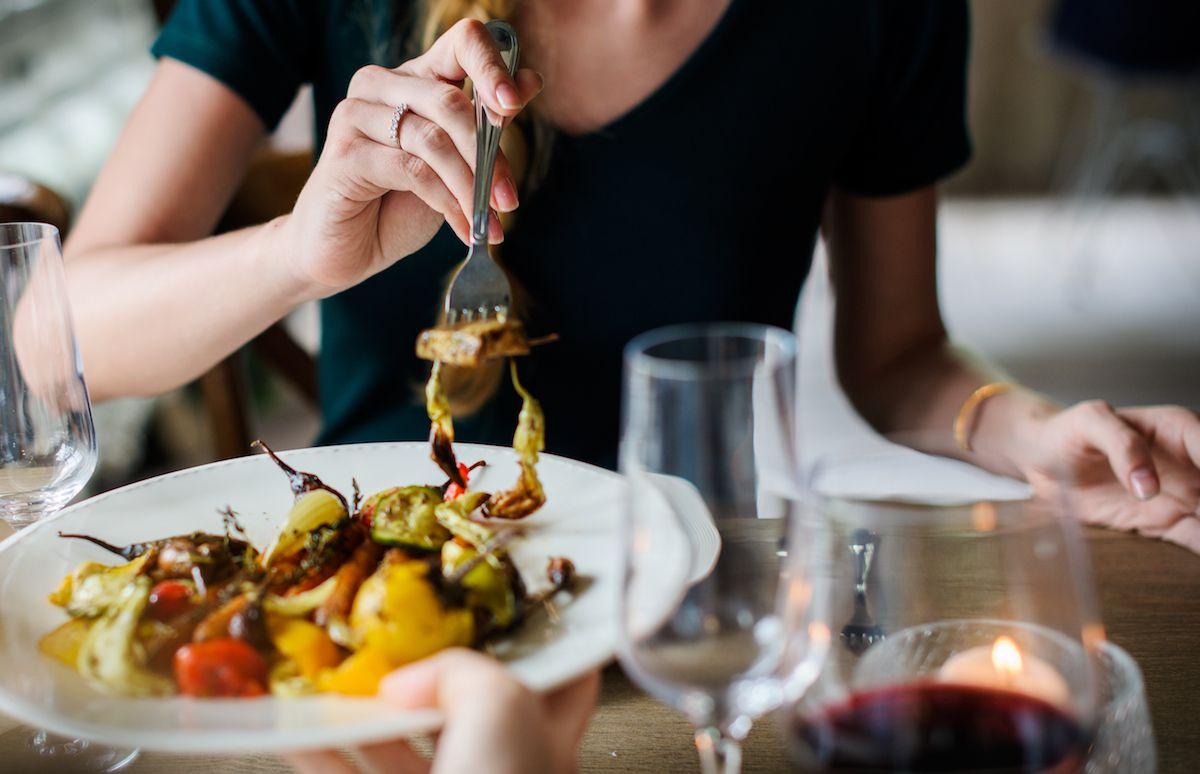 Woman enjoying a meal / Shutterstock