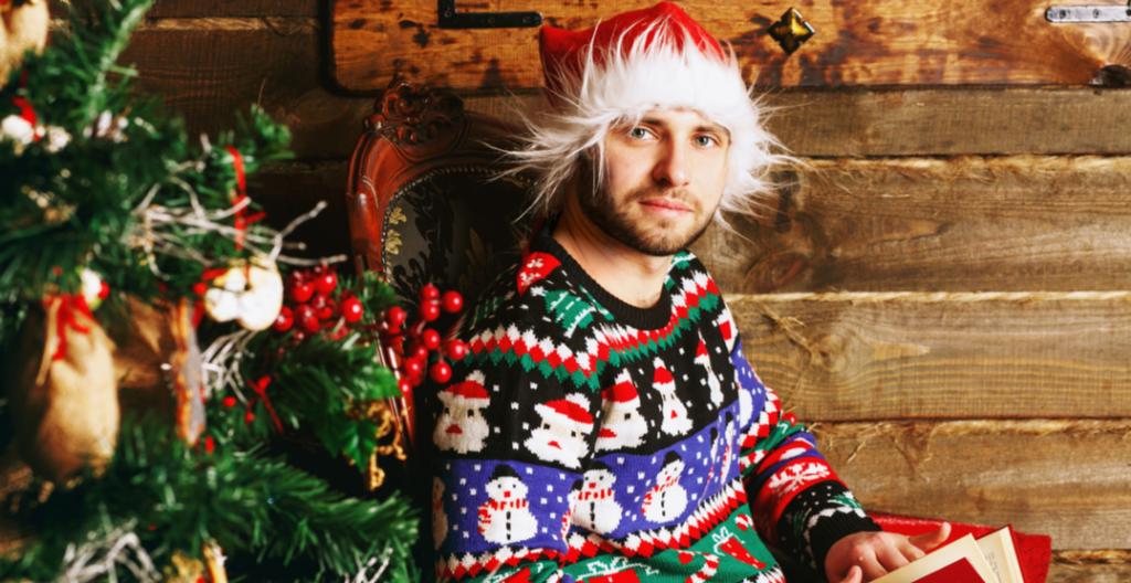 Man in an ugly Christmas sweater (IVASHstudio/Shutterstock)