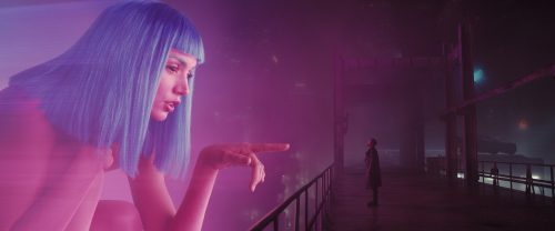 A Joi hologram advertisement interacts with K in Blade Runner 2049 (©2017 ALCON ENTERTAINMENT, LLC., WARNER BROS. ENTERTAINMENT INC. AND COLUMBIA TRISTAR MARKETING GROUP, INC. ALL RIGHTS RESERVED.)