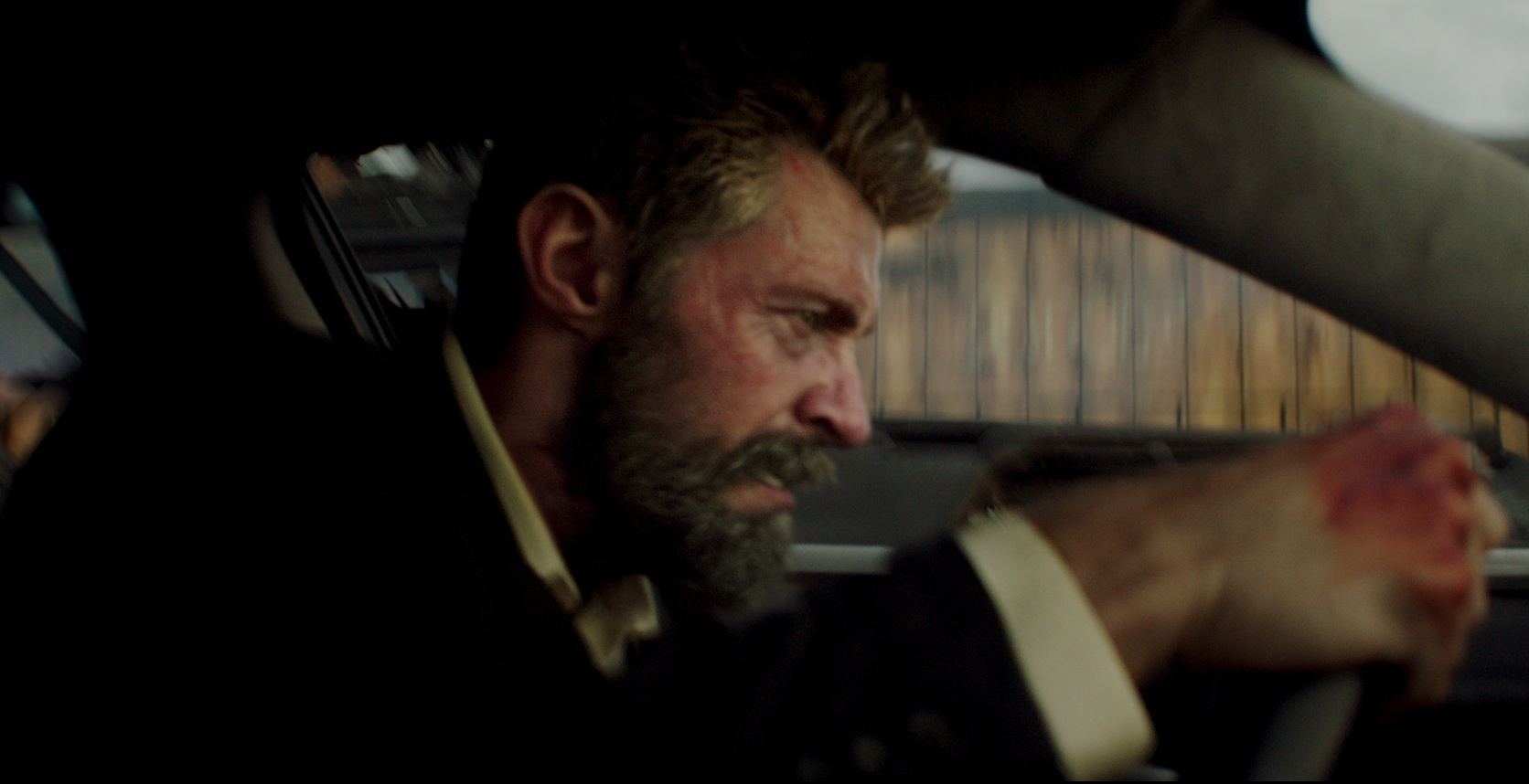 Final shot of hugh jackmans digital head and the stunt mans body in logan feature