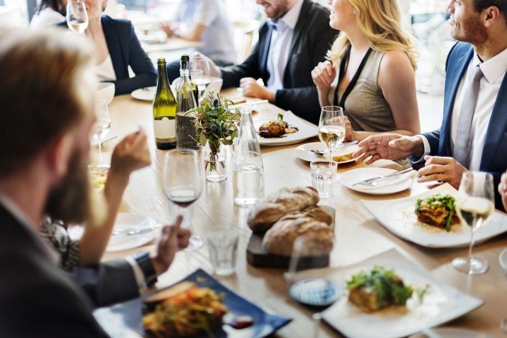 Shutterstock_Friends eating at a restaurant