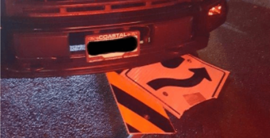 Driver caught in Vancouver... with road signs stuck under vehicle