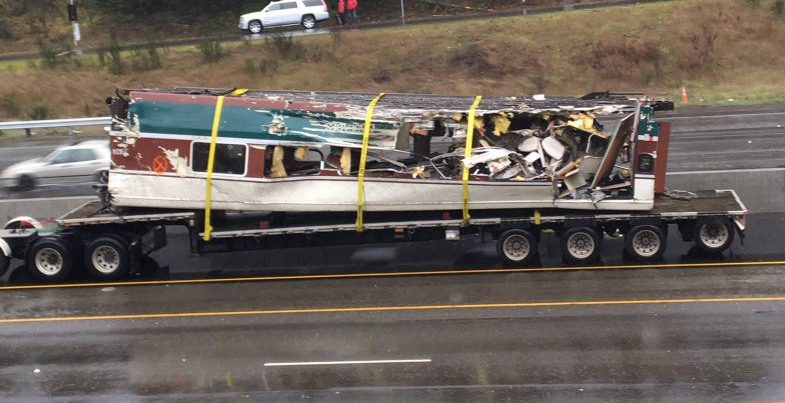 One of the derailed cars of the amtrak cascades train being removed from the crash site washington state patrol