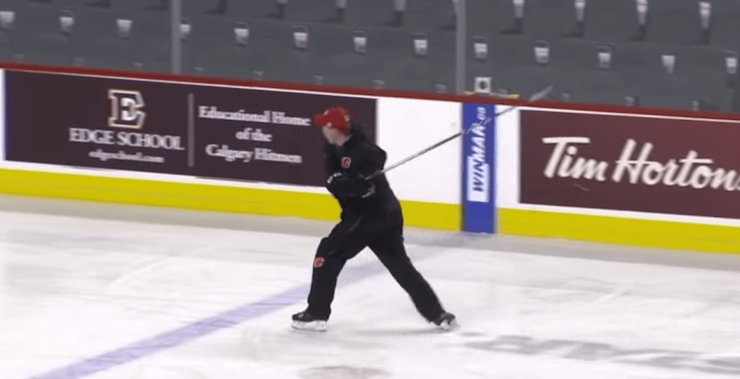 Flames coach freaks out at his team, launches stick into stands (VIDEO)