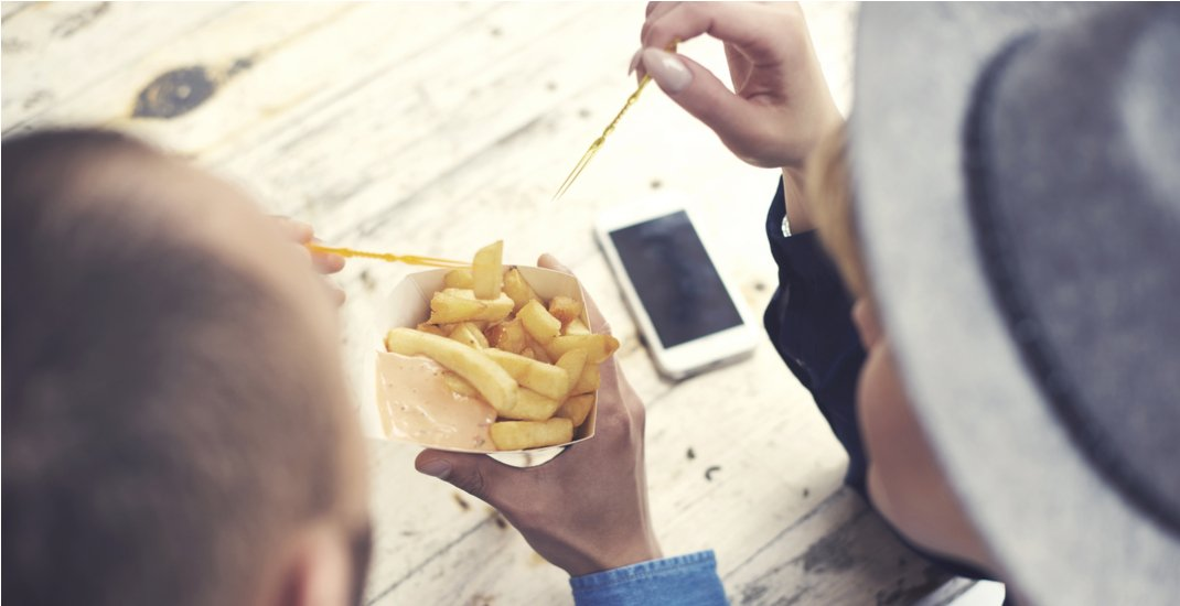 Sharing french fries / Shutterstock