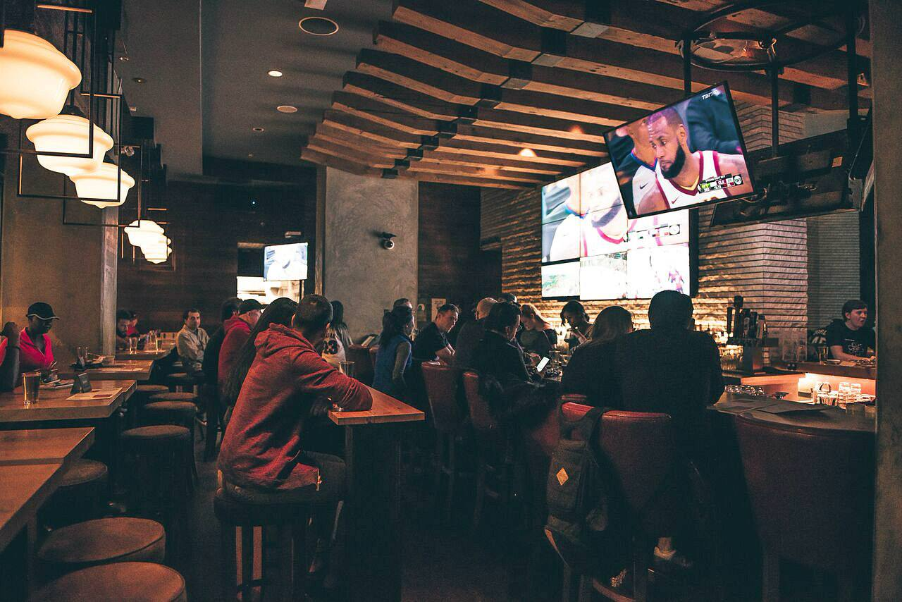 The Charles Bar will buy you a beer on Fan Tuesdays, under 1 condition