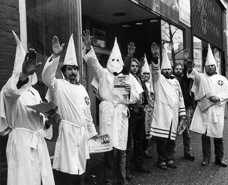 Klansmen leafletting on East Hastings Street, February 1982. Photo by George Diack for the Vancouver Sun.