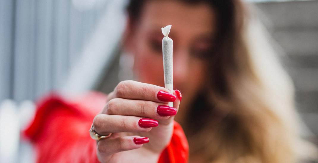 Woman holding joint cannabis