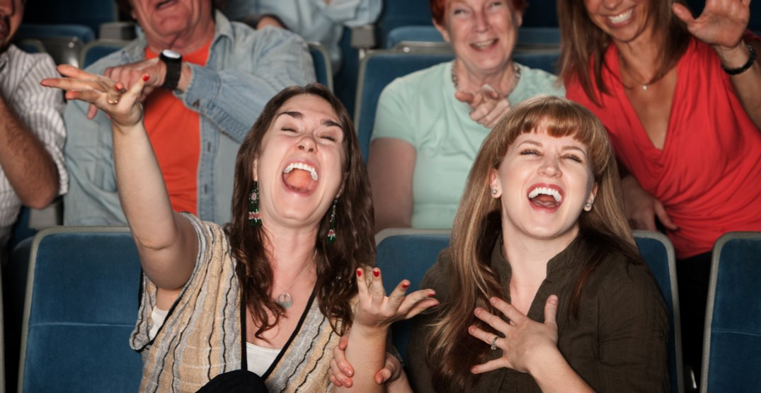 People laughing in theatre