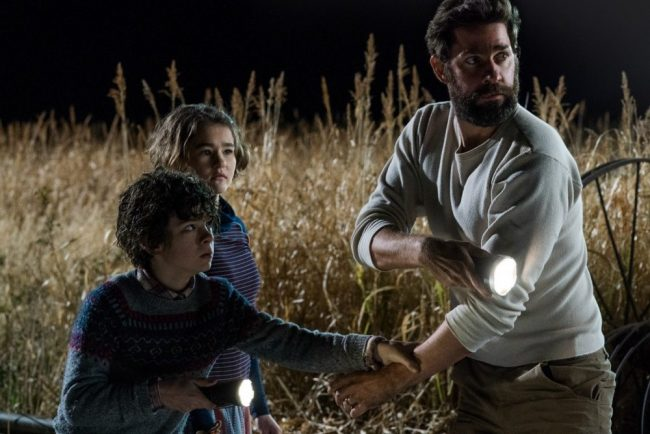 Left to right: Noah Jupe plays Marcus Abbott, Millicent Simmonds plays Regan Abbott and John Krasinski plays Lee Abbott in A QUIET PLACE
