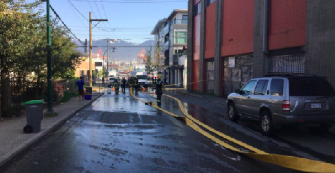 Vancouver motorist drives over fire hose while crews are fighting fire