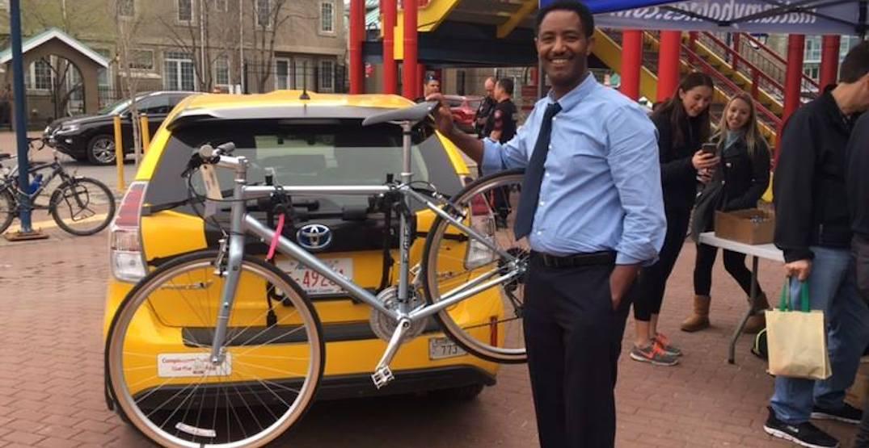 Checker Cabs installs bike racks on their fleet for Bike To Work Day