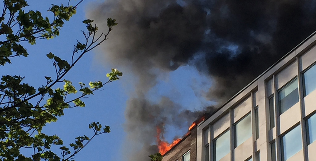 Firefighters take to downtown as blaze breaks out at St. Catherine Street building