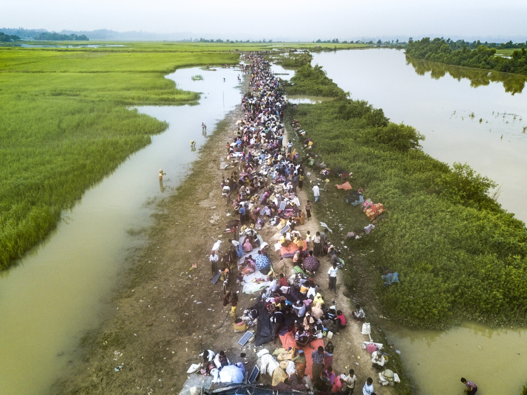 Thousands of new Rohingya refugee arrivals cross the border near Anjuman Para village, Palong Khali, Bangladesh.