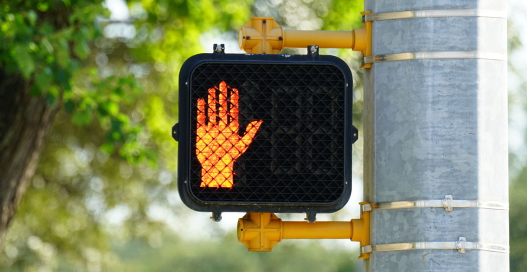 You can be fined $100+ in BC for entering a crosswalk after 'Don't Walk' signal starts