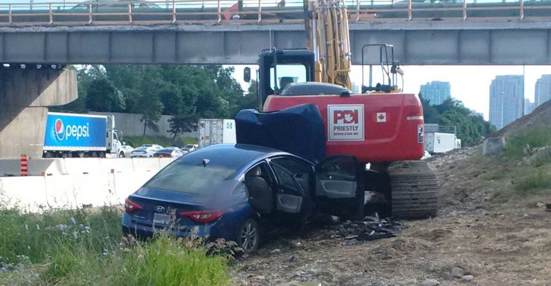 Woman in critical condition after slamming into parked excavator