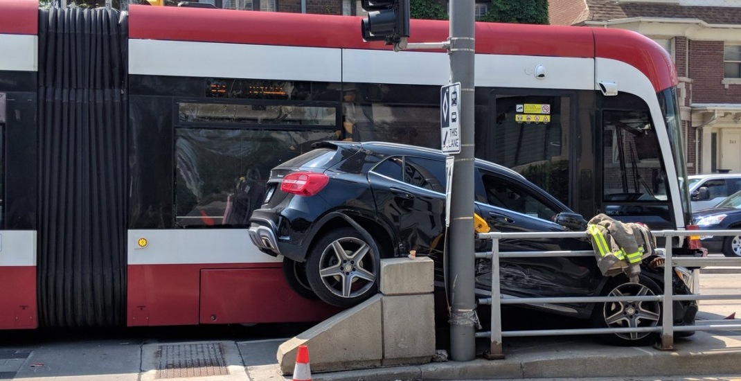 Car gets squashed between streetcar and pole in bizarre accident over the weekend