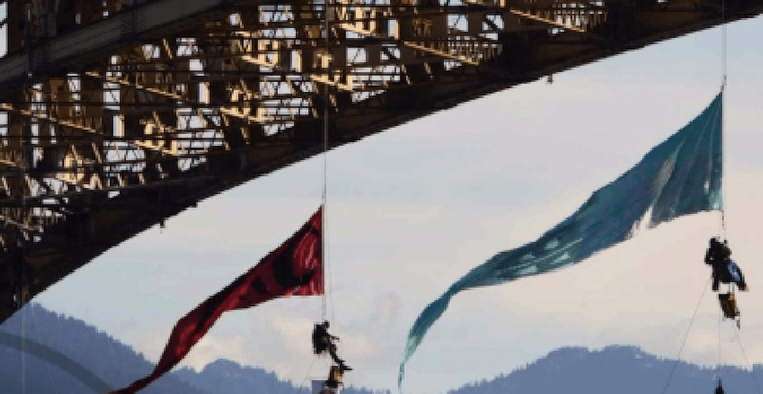 12 people rappelled off the side of Ironworkers Bridge Tuesday morning in protest