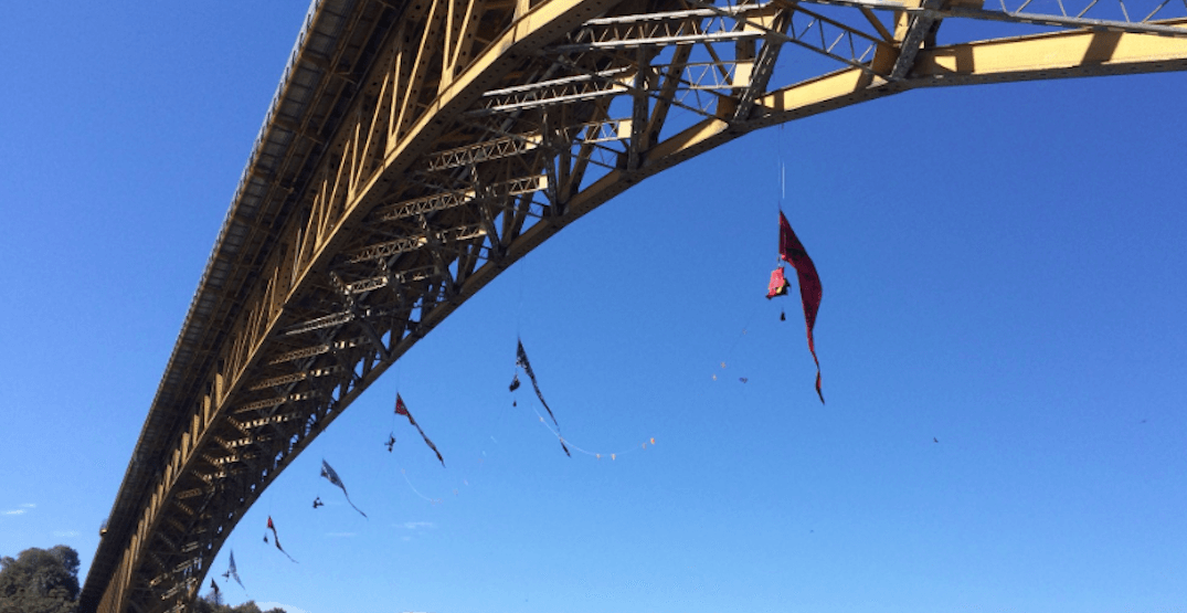 Police begin removing protesters dangling from Ironworkers Bridge since yesterday