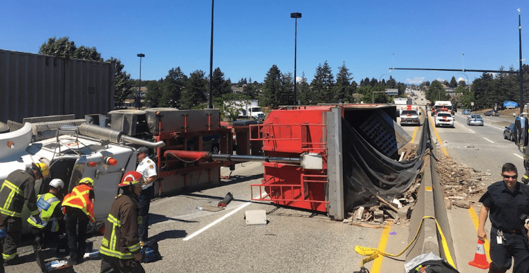 Knight Street Bridge closed in both directions after semi-truck rollover