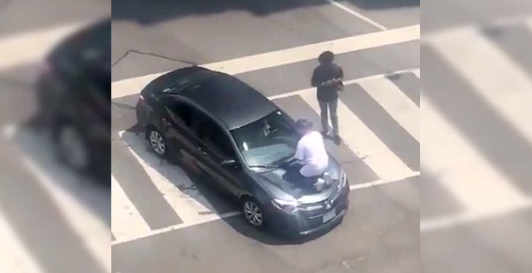 Man arrested after stomping on car at downtown intersection (VIDEO)