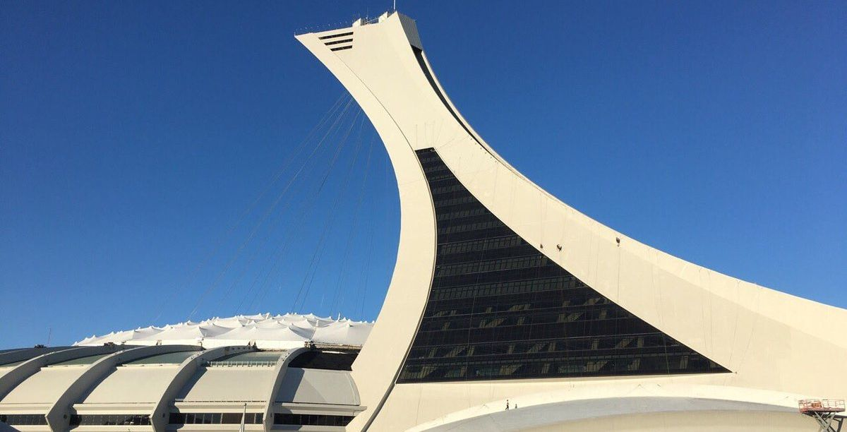 Greenpeace activists are protesting by climbing Olympic Stadium this morning