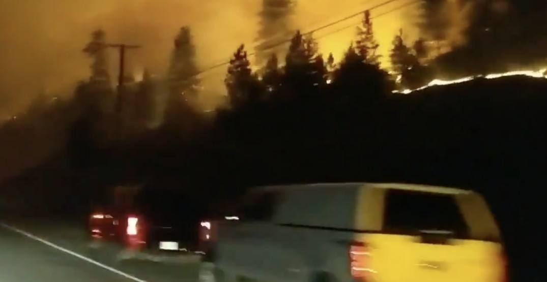 Video footage shows BC wildfire getting dangerously close to drivers on highway